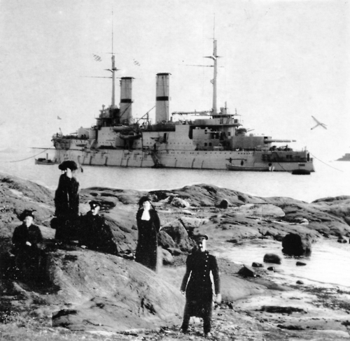 The Slava at anchor off an unanmed inlet on the Finnish coast (Finalnd was part of Tsarist Russia at the time) guarding the Tsar and his yacht while the monarch, his family, and his suite relax ashore