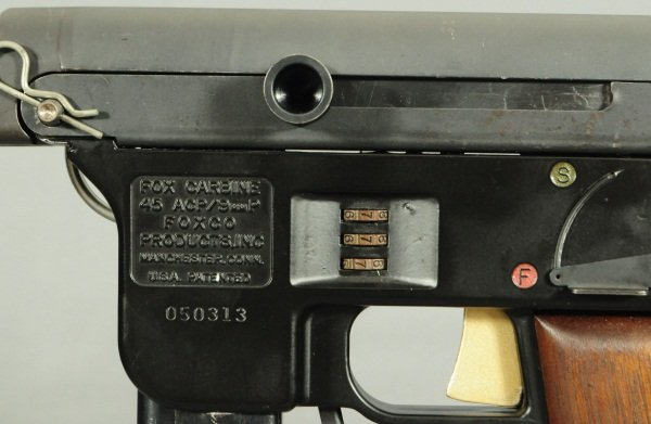 Yes, thats a combination lock on the side of the gun....