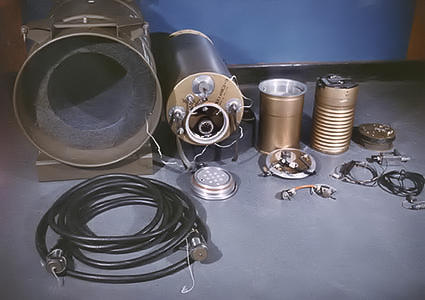 A view of the interior components of the W45 MADM, showing (from left) the packing container, warhead, code-decoder, and firing unit. The MADM was a similar design to the SADM