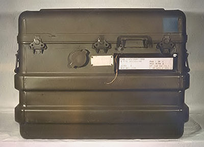 The locked storage suitcase that the SADM rested in when not being hurled out of airplanes, smuggled over the boarder on the back of a yak, or going for a drag by a frogman