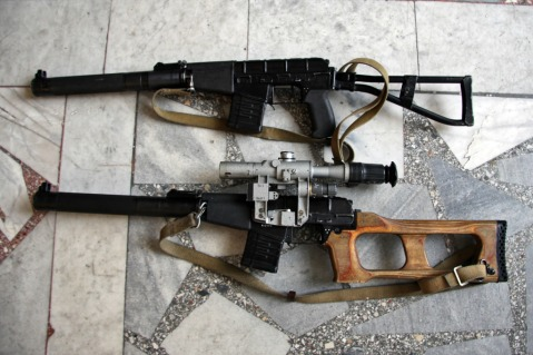 AS on top with folding stock and VSS on bottom with fixed wood stock the guns share internals