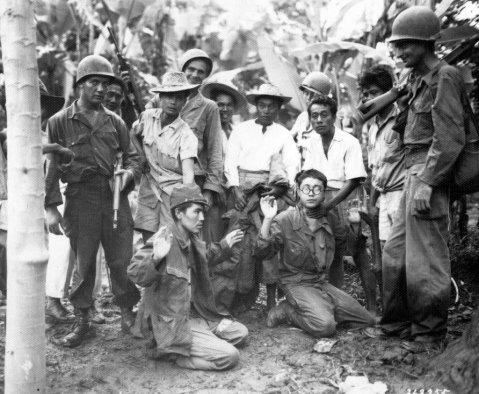 filipino guerillas and us troops worked hand in hand behind japanese lines in the PI during WWII