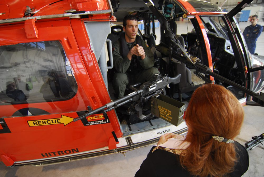 JACKSONVILLE, Fla. – Petty Officer 2nd Class Anthony Phillips, a precision marksman at Helicopter Interdiction Tactical Squadron, shows a group of VIPs the weaponry used at HITRON during missions Tuesday Feb. 23, 2010. The VIPs were at HITRON to view an advanced screening of an upcoming episode of Top Sniper featuring HITRON on the Military Channel Thursday at 9 p.m. EST. (U.S. Coast Guard photo by Petty Officer 1st Class Bobby Nash.)