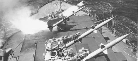 Mississippi firing Terrier missiles in 1955. This hybrid missile/gun arrangement was a wet-dream for battleship advocates for the next fifty years. When the Iowa class were eventually recommissioned in the early 1980s, they were given 16 harpoon anti-ship missiles and 32 Tomahawk cruise missiles in place of a few of the 5-inch twin mounts.