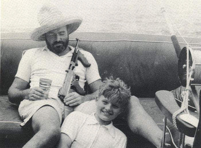 hemingway and son Jack waiting for a bite on the pilar with his tommy gun in hand note the massive size of the reel