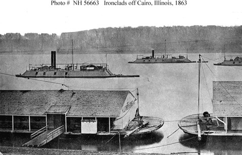 Off Cairo, Illinois, in 1863, with barges moored in the foreground. These ships are (from left to right): USS Baron de Kalb (1862-1863); USS Cincinnati (1862-1865) and USS Mound City (1862-1865). Boats are tied astern of Baron de Kalb and Cincinnati. U.S. Naval Historical Center Photograph.