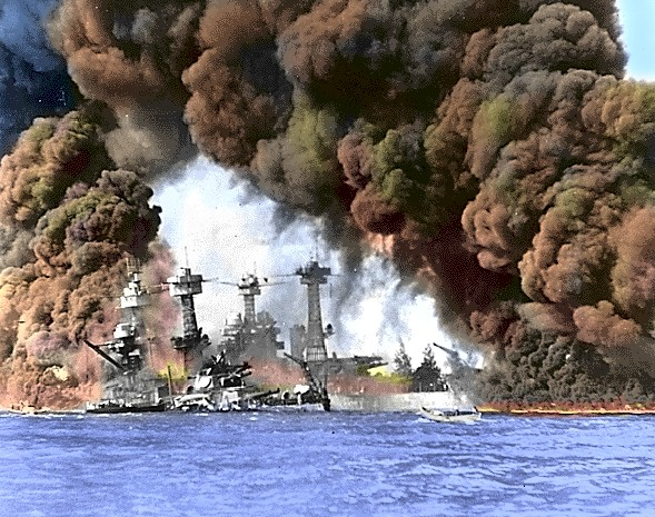 The West Virgina is seen forward, settled and burning after 7 torpedo hits. Half-sister USS Tennessee is just behind her
