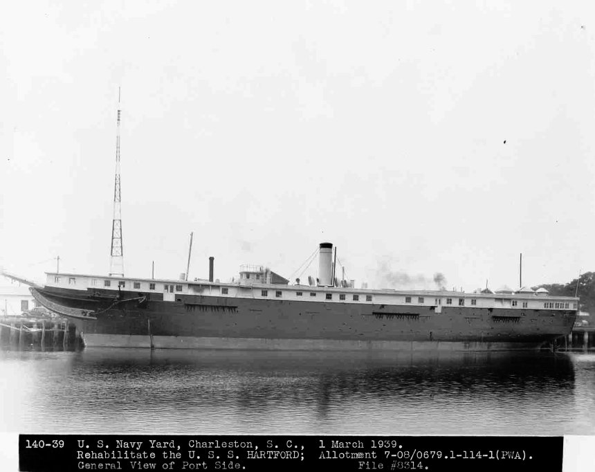 During WWII she sat at Norfolk, her transition to a museum ship put off indeffinatly by the war. Note that her masts have been stepped at the deck level.