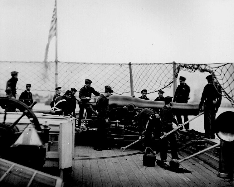 Here we see a A 9-inch Dahlgren smoothbore naval gun and crew in the stern pivot position of USS Miami, 1864. The Hartford carried 20 of these bad boys, each of which could fire a 75-pounds shell over 3400-yards, which was devastating for the time.