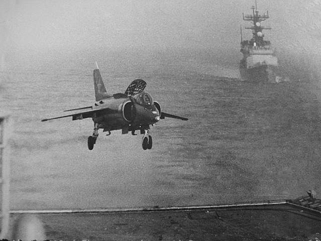 Spruance class destroyer USS Peterson (DD-969) keeping tabs on YAK 38 Forger most likely landing on a Soviet Kiev class carrier