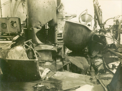 damage to her amidships from the bomb dropped by her own navy