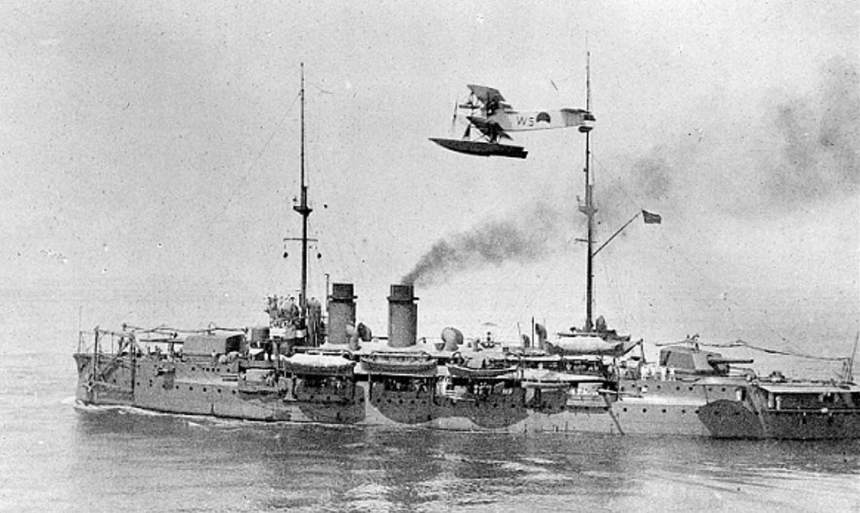 Wearing a more modern battleship grey scheme in the 1930s, the DZP is seen here with a Dutch Navy Fokker floatplane overhead
