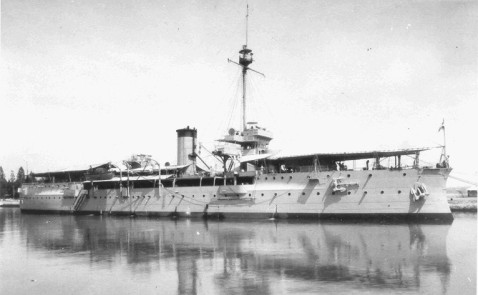 As the Soerabaia after 1936. Note her secondary armarment is gone, her second funnel is gone (as 5 out of 8 boilers were removed) and her main battery is covered by tarpaulins.  Its questionable if by this stage of her life her 11-inch Krupp guns were even still supportable.