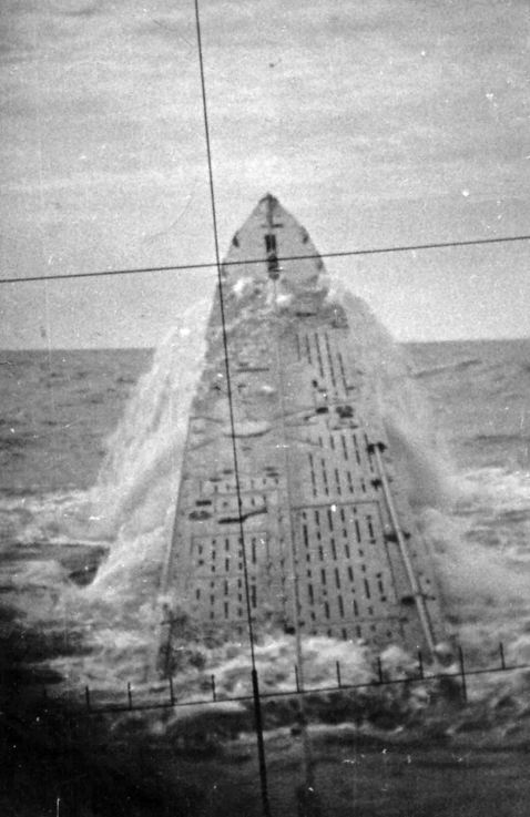 "Famous picture of U-427 crashing the surface. Emergency ascent, the so-called ""killer whales jump"" (""whale jump""), of German submarine U-427. The picture was taken through the periscope of a submarine"