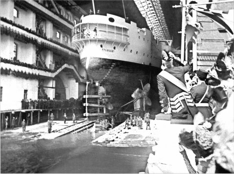 The Russian cruiser Gromoboi shortly before its launch note imperial footman leaning over to get a better view.