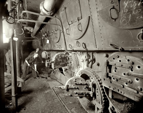 U.S.S. Massachusetts, fire room 1897 note the chalk on the boiler hatches