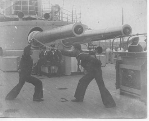 Naval cutlass practice under the monitors guns.