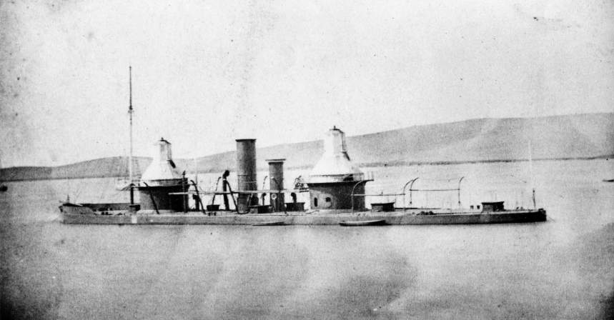 The original wooden‑hull, double-turreted, 1863 ironclad monitor USS Monadnock, complete with a Ericsson vibrating lever engine and pair of Civil war standard 15-inch smoothbore Dahlgren guns, circa 1866 in the Mare Island channel. USN photo courtesy of Darryl L. Baker.