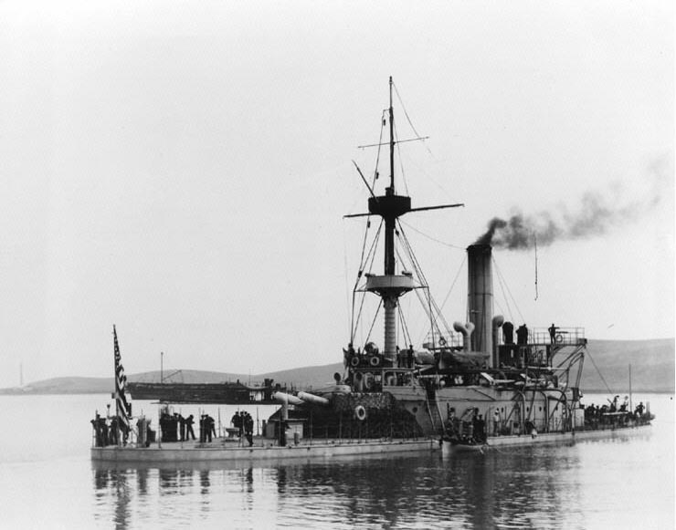 Stern shot of the monitor USS Monadnock off the Mare Island Navy Yard, CA, June 1898, ready for her voyage to the Philippines. The old monitor 800-ton Passaic-class monitor USS Camanche (1864-1899), at the time training ship for the California Naval Militia, is visible beyond Monadnock's after turret.  (Photograph courtesy of the US Navy Historical Center)