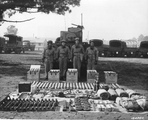 M3 light tank, crew, and supplies at Fort Benning, Georgia note the Tommy gun and ten drums up front