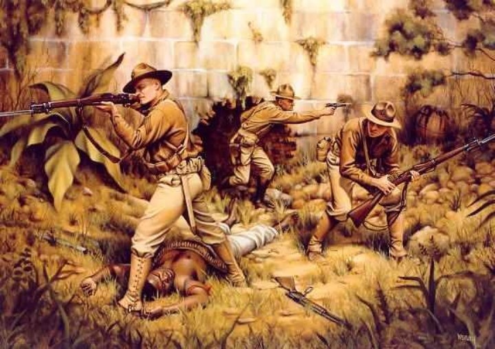 Future General Smedley Darlington Butler in 1915 earned his *second* Medal of Honor with only two Marines beside him, against a force of insurgents in Haiti. That's Butler, as a 34-year old Major– he's the one with the 1911.