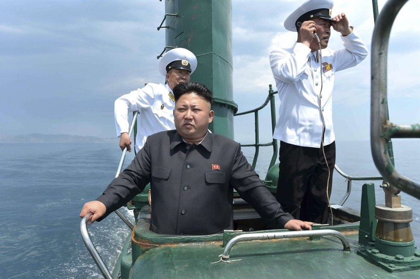 North Korean leader Kim Jong Un stands on the conning tower of a Romeo-class submarine during his inspection of the Korean People's Army Naval Unit 167 in this undated photo released June 16, 2014.