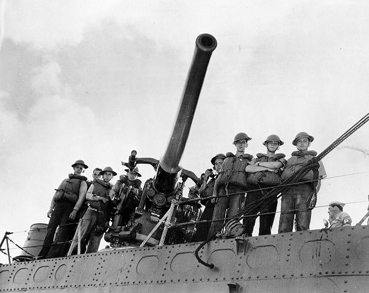 """A Shot for Posterity — The USS Ward's number three gun and its crew-cited for firing the first shot the day of Japan's raid on Hawaii. Operating as part of the inshore patrol early in the morning of December 7, 1941, this destroyer group spotted a submarine outside Pearl Harbor, opened fire and sank her. Crew members are R.H. Knapp - BM2c - Gun Captain, C.W. Fenton - Sea1c - Pointer, R.B. Nolde - Sea1c - Trainer, A.A. De Demagall - Sea1c - No. 1 Loader, D.W. Gruening - Sea1c - No. 2 Loader, J.A. Paick - Sea1c - No. 3 Loader, H.P. Flanagan - Sea1c - No. 4 Loader, E.J. Bakret - GM3c - Gunners Mate, K.C.J. Lasch - Cox - Sightsetter."""
