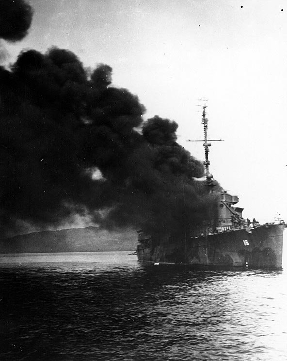 "Ward (APD-16, ex-DD-139) on fire after she was hit by a ""Kamikaze"" in Ormoc Bay, Leyte, 7 December 1944"