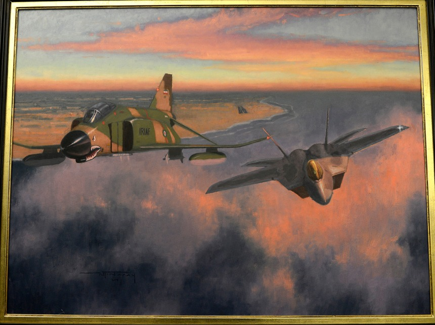 """""""Showtime,"""" is a piece of art painted by Air Force Reserves historian, Maj. Warren Neary, and was presented to Air Force Chief of Staff Gen. Mark A. Welsh III in the Pentagon, June 20, 2014.  Neary contributed """"Showtime,"""" and another work, """"Bandage 33,"""" through the Air Force Art Program, and Chief of Air Force Reserves Gen. James """"JJ"""" Jackson unveiled the two pieces for Welsh.  (U.S. Air Force photo/Scott M. Ash)"""