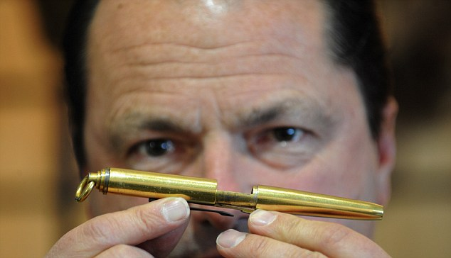 """rossparry.co.uk/syndication/Yorkshire Post Picture shows Nicholas Holt with an amazing pen which hides a secret pistol. The gold-plated pistol Pen was given to Lord Mountbatten for his protection by his friend The Maharaja of  Jodphur in case he ever fell into the wrong hands. The handmade pen - worthy of a James Bond-type scene - is due to go under the hammer once again at an auction in March, and is estimated to fetch between 5-7,000 pounds. Nicholas Holt, founder of Holt's Auctioneers, which is selling the item said: """"The Maharaja of Jodphur built it for his friend in case he got himself in a position where he had to sign something which he did not wish to sign - either  to kill himself or the enemy."""""""