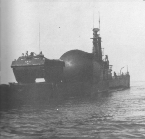 Yes, this IS a submarine with an Amtrac aboard. Perch (ASSP-313) preparing to launch an LVT amphibious tractor during a 1949 exercise. The vehicle could be carried in the cargo hangar and launched by flooding down the submarine. USN photo and text from The American Submarine by Norman Polmar, courtesy of Robert Hurst.