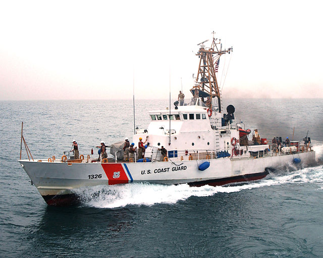 Persian Gulf (April 27, 2005) – Coast Guardsmen aboard U.S Coast Guard Cutter Monomoy (WPB 1326) wave good-bye to the guided missile cruiser USS Antietam (CG 74) after the first underway fuel replenishment (UNREP) between a U.S. Navy cruiser and a U.S. Coast Guard Cutter. Antietam completed fuel replenishment with the Monomoy in about two hours and saved the 110-foot patrol boat a four-hour trip to the nearest refueling station. Antietam and Monomoy are conducting maritime security operations (MSO) in the Persian Gulf as part of Commander, Task Force Five Eight CTF-58). U.S. Navy photo by Journalist Seaman Joseph Ebalo (RELEASED)