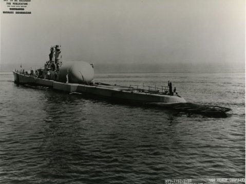 Aft view of the Perch (SS-313) off Mare Island after completion of conversion to a troop transport. Note the large dry deck shelter for equipment and small boats. US Navy photo