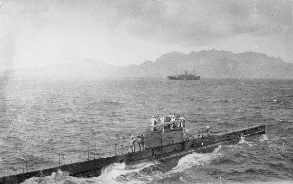 On route to take part in the Dardanelles campaign, the AE2 is making her own way into Aden after being towed across the Indian Ocean by the transport HMAS Berrima (background). Australian War archive P02029.027