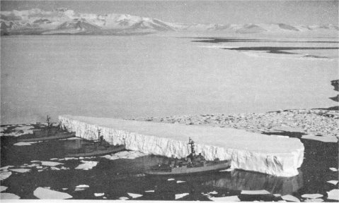 From left to right, USS Burton Island (AGB-1), USS Atka (AGB-3) and USS Glacier (AGB-4) pushing an iceberg out of the channel near McMurdo Station, Antarctica, 29 December 1965. US Navy photo from DANFS.