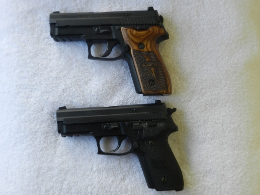 Two SIG P229R pistols. the top is a DAK trigger model, while the bottom is a DA/SA model.
