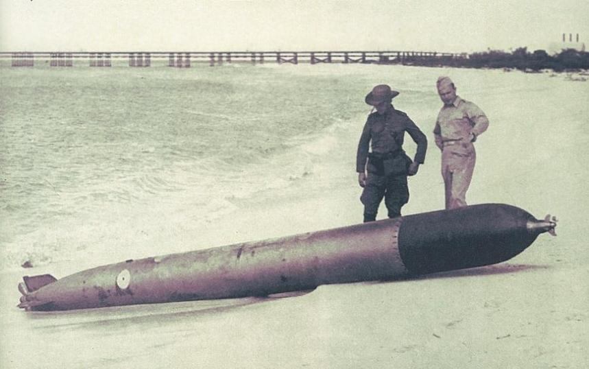 German U-boats haunted the Dutch West Indies in 1942. The image above shows a torpedo that ran up on Eagle Beach in Aruba 16 Feb 1942. Fired from U-156, it missed the Texaco tanker Arkansas, berthed at Eagle Pier (although a second hit the ship). Shown being inspected by an unidentified Dutch Marine (Korps Mariniers) officer and U.S. Army Capt. Robert Bruskin, the steel fish was very much still a live war-shot round. It later killed four Dutch Marines who tried to disassemble it for study. Photo from LIFE March 2, 1942