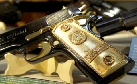 Mexican Army's Narco War Museum: A captured 1911 colt with Versace grips (Photo by Ross McDonnell)