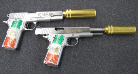 Bonus: A pair of 1911 Narco pistols captured by the Federales, complete with Republic flag grips, El Jefe slide scrolls, and brass suppressors. You are welcome.