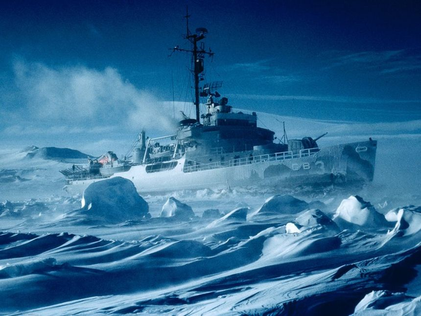 U.S.S. Atka stands in McMurdo Sound to keep the channel open for Operation Deep Freeze supply ships and the evacuation of the last summer residents.