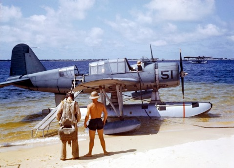 OS2U-3 Kingfisher at the edge of the seaplane ramp at NAS Pensacola, Florida, United States, 1942. Note Consolidated P2Y flying boat laying off shore. (Click to big-up)