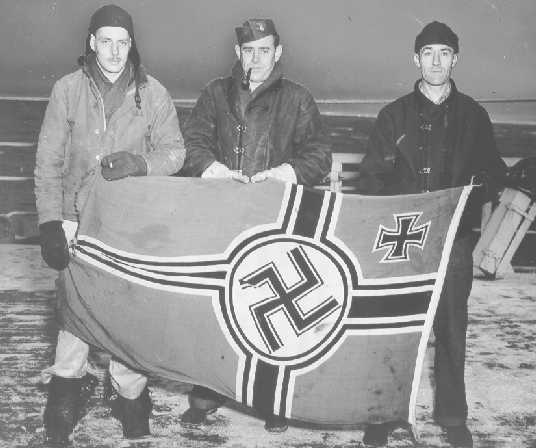 USCG landing parties with captured Nassy battleflag