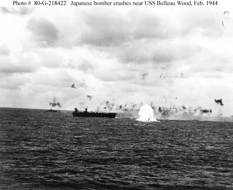 Carrier Raids on the Marianas, February 1944. A Japanese bomber explodes as it crashes into the sea near USS Belleau Wood (CVL-24), during an attack on Task Group 58.2 off the Mariana Islands, 23 February 1944. Photographed from USS Essex (CV-9).Official U.S. Navy Photograph, now in the collections of the National Archives. (Photo # 80-G-218422). From Navsource