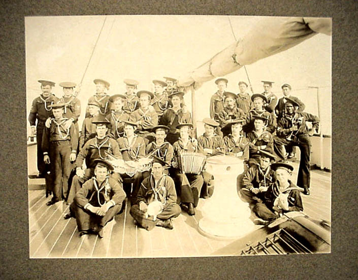 http://lighthouseantiques.net/Revenue%20Cutter%20Serv.htm Crew of the Gresham around 1900. Note the old school Donald Duck caps.