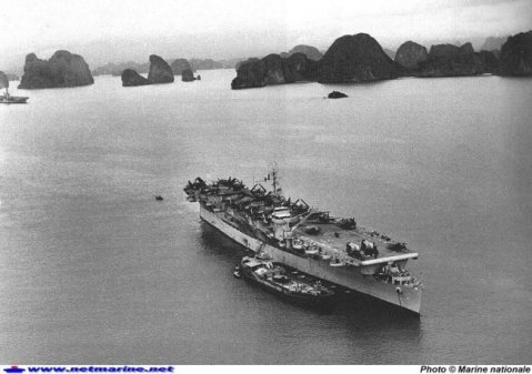 aircraft carrier Belleau Wood in Haiphong Bay, 1954, while in French service. Note he impressive air wing aboard of at least a dozen F6Fs and Helldivers plus two HUP-2's forward