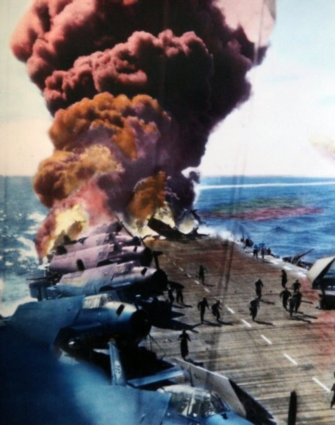 USS Belleau Wood (CVL-24) burning aft after she was hit by a Kamikaze, while operating off the Philippines on 30 October 1944. Flight deck crewmen are moving undamaged TBM torpedo planes away from the flames as others fight the fires. USS Franklin (CV-13), also hit during this Kamikaze attack, is afire in the distance. Official U.S. Navy Photograph, now in the collections of the National Archives. (Photo # 80-G-342020).FromNavsource.