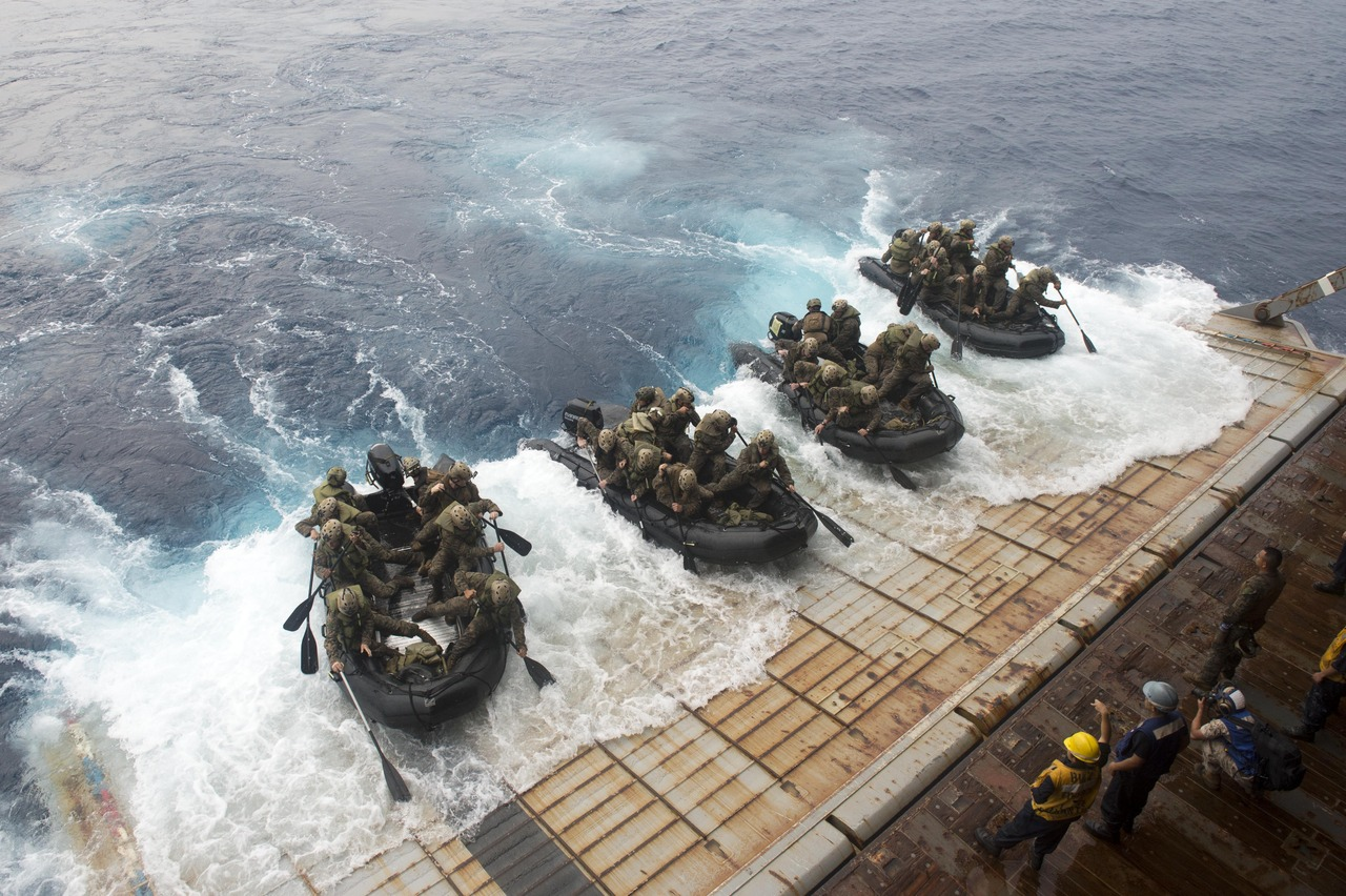 140910-N-UD469-180 PHILIPPINE SEA (Sept. 10, 2014) Marines, assigned to the 31st Marine Expeditionary Unit (31st MEU), depart the well deck of the amphibious dock landing ship USS Germantown (LSD 42) in combat rubber raiding crafts during amphibious operations. Germantown is part of the Peleliu Amphibious Ready Group and is conducting joint forces exercises in the U.S. 7th Fleet area of responsibility. (U.S. Navy photo by Mass Communication Specialist 2nd Class Amanda R. Gray/Released) -Click to big up-