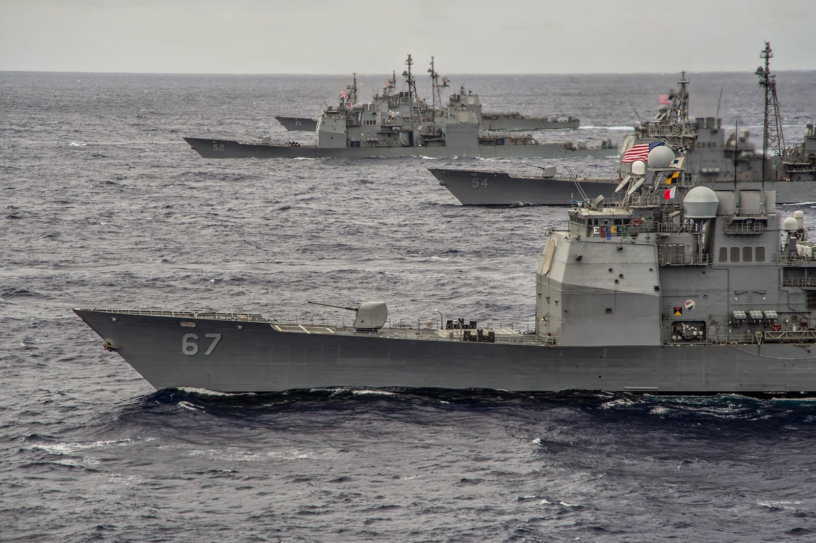 PACIFIC OCEAN (Sept. 23, 2014) The Ticonderoga-class guided-missile cruisers USS Shiloh (CG 67), foreground, USS Antietam (CG 54), USS Bunker Hill (CG 52), and USS Cape St. George (CG 71) from the George Washington and Carl Vinson Carrier Strike Groups transit in formation at the conclusion of Valiant Shield 2014. The U.S.-only exercise integrates Navy, Air Force, Army, and Marine Corps assets. (U.S. Navy photo by Mass Communication Specialist 1st Class Trevor Welsh/Released) --Click to big-up