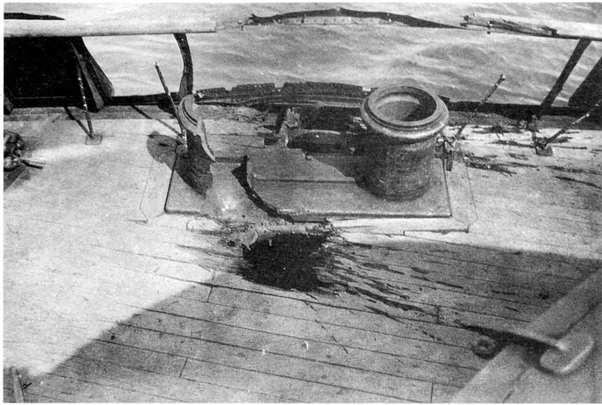 A Japanese 6-inch shell through her deck