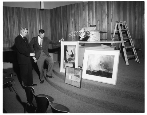 """A trio of controversial paintings by Michiagn University Professor William A. Lewis entitled """"Notices on the Gates of Hell."""" at First Unitarian Church, April 1963. Photo by Ann Arbor News http://oldnews.aadl.org/aa_news_19630412-artists_work"""